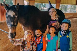 Children horse and staff member